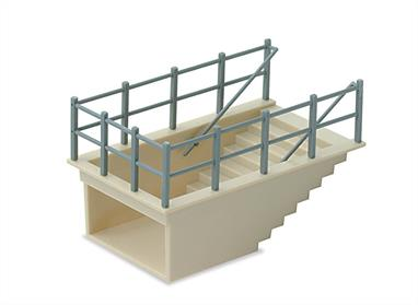 Subway Staircase kit. Designed to fit into a platform top without the need to cut a hole in the baseboard. The kit contains parts to build two subway staircase units which can be modified to form one greater depth if required. Although designed primarily for use on stations, the 20th century townscape provides many other oppertunities for use such as, an u7nderpass, public convieniences, road junction or tourist attraction. L:60mm D:20mm W:34mm.