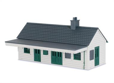 Peco OO LK-200 Wooden station building kit.Filling the gap for a wooden station building in the Peco OO gauge Lineside Kits range this building is a typical locally constructed wooden structure as could be found at wayside stations on cross-country routes and branchlines. The generic in design represents a structure with horizontal wooden boards, and can be built with or without the canopy.This is a mixed media kit with wood and plastic parts. The main structure including floor and walls have been produced from MDF, laser cut and engraved with planking lines. Moulded plastic window frames, roof tile sheets and detailing parts are drawn from Pecos' existing kits and LK-78 and LK-79 building detailing sets. Assembly is very straight forward as the clear exploded diagrams on the instructions guide the builder through each stage. The laser cut detail of the canopy brackets are particularly eye-catching. Being a generic model intended to recreate a locally built wooden structure the kit can easy be modified to create a sports pavilion, large shed/workshop, office building for a coal, builders or timber merchants' yard or even a beach cafe of the type found alongside many seaside promenades.