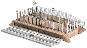 A common feature of country stations large and small, whilst market town cattle docks could be very large indeed. Our model is of the one at Yeovil Pen Mill (GWR) Station, Somerset. Livestock (Modelscene Cows Ref. 5100, Sheep and Lambs Ref. 5110, Pigs Ref. 5108, and Horses Ref.5105) was conveyed on British railways until around 1973, although many cattle docks remained in place unused, becoming overgrown - an interesting scenic feature. Supplied with pre-coloured parts although painting and/or weathering can add realism; glue is required to complete this model. Footprint 170mm x 110mm