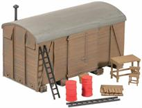 Usually used for storage around the station or goods yard, they often can be found being used as sheds or on farmland. Clutter included; supplied with pre-coloured parts although painting and/or weathering can add realism; glue is required to complete this model. Footprint 176mm x 90mm