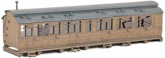 If you have a large goods yard on your layout, this would make a good mess coach for the staff. It could also be used as a dwelling or provide sleeping accomodation on a campsite. Includes clutter; glue and paints required to complete model. Footprint: 195mm x 45mm