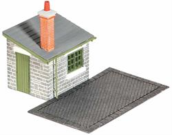 Many goods yards had weigh bridges so that the 'carriage price' of a load to be carried by rail could be costed. Goods were then loaded into the goods shed. Supplied with pre-coloured parts although painting and/or weathering can add realism; glue is required to complete this model. Footprint; Weighing Deck 85mm x 50mm, hut 45mm x 35mm.