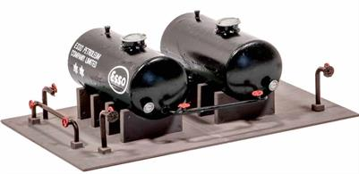 A very useful set of oil storage tanks. Designed for use with oil depot kit 529, these have many other uses like fuel storage for diesel locomotive depots.
