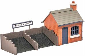 In the days when everything came by rail, even the smallest goods yard would provide a facility for the local coal merchant next to a siding. The Ratio 526 Coal Sacks kit and Peco Scene Real Coal Refs PS-330,1 and 2 can provide extra detailing, as can the Modelscene Coalman and Scales Ref. 5029. Supplied with pre-coloured parts although painting and/or weathering can add realism; glue is required to complete this model. Footprint 140mm x 30mm