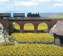 A kit providing 96 sunflowers sized for N gauge model railways. Self-coloured plastic mouldings are used to quickly assemble an entire field of sunflowers.Designed for N scale model railway scenes, but useful for dioramas and architectural models in the 1/100 to 1/200 scale range.