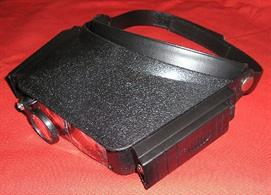 A lightweight headband magnifier unit fitted with a torch light to provide strong, direct lighting on the area being viewed.