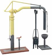 A simple plastic kit of the GWR standard pattern water crane, complete with base and control column. A drain grille with water catcher funnel is supplied to be positioned under the water bag in the rest position along with a fire devil with tall chimney.The fire devil is a small coal burning stove type device. The GWR and most other companies used these with the tall chimney ending just below the arm of a water crane to ensure that the water crane did no freeze up in cold weather.