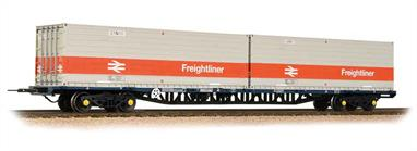 These were the firsttype of container flat wagons built by British Rail and formed into sets of wagons, each wagons being designed to carry 3 20-foot containers. As these formations of (usually) five wagons were intended to be fixed formations the outer wagons were fitted with side buffers and conventional couplings at one end only. The inner end of the wagons and both ends of the inner wagons had fixed bar couplings which were intended to be uncoupled only at repair depots.The Freightliner flat models feature details such as linkage, pipe work, close couplings, in-board disc-brake detail and sprung buffers. For fixed rake operation the models feature fixed bar couplings between wagons with standard tension lock couplings in NEM pockets at the outer ends. The wagon deck is of die-cast metal construction, giving weight and stability to the vehicle. This model is one of the inner wagons, these had bar couplings only so would run between two outer wagons, so is designed as an extra wagon to run with the 38-625 pair of outer type wagons.Each wagon length approx 260mm/10.25in.