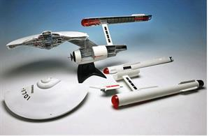 "The U.S.S. Enterprise from STAR TREK: The Original Series is one of the most indelible spacecraft in all of sci-fi. This re-issue of the AMT Enterprise Cutaway kit showcases the inner workings of the classic ship. It can be built to expose inner workings such as the bridge, shuttle hangar and warp nacelles or it can be built as a complete ship. A decal sheet is included to add all exterior markings and windows as well as some interior details as well.The kit has been upgraded to incorporate Round 2's standard dome display base with metal support tube.Product Features:		Scale: 1:537Skill Level: 2 (ages 10 and up)Build as full ship or as a cutawayNearly 22"" longExpanded decal sheetHighly detailed model"