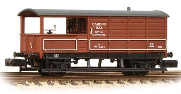 Detailed N gauge model of the GWR standard design of goods train brake van finished in British Railways bauxite brown livery.