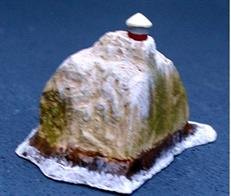 A 1/1250 scale model of Rockall with waves breaking at the base, the westernmost part of the British Isles was fitted with a lighthouse in 1972.