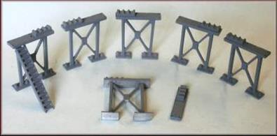 Set of 8 supporting girder 'legs' cast in whitemetal. Ideal for use as bridge supports providing clearance for N gauge trains to pass beneath. Supplied with pipe rack parts and steps to allow the supports to be used for pipe bridges etc.