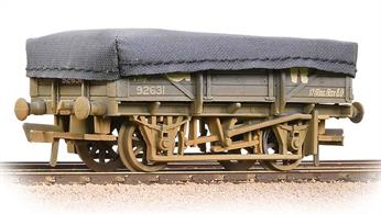 Model of a 5 plank end door china clay wagon in GWR grey livery. These wagons were used to convey china clay from the clay dries at the quarries to the UK potteries, paper plants and ports for export. When loaded the wagons were covered by a tarpaulin to prevent contamination of the load.Cornwall was the main source for china clay so the GWR owned a fleet of these wagons, with more being built by British Railways after nationalisation, these later wagons remaining in service until the early 1980s.Era 3 1923-1948 (grouping)