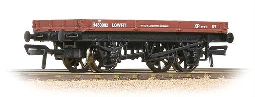 A good model of the BR single-planked lowfit wagon. These useful wagons could convey loads which required only a flat wagon to carry. This includes crated loads and road vehicles. These loads could easily be chained down, while the low sides ensured that any loose items like chain ends were retained within the wagon in transit.Lowfit wagons were marked as unsuitable for carrying containers as they did not have the lashing rings fitted to purpose-built container flats, but railwaymen found that containers could just as easily be secured by ropes around the buffers.Era 5