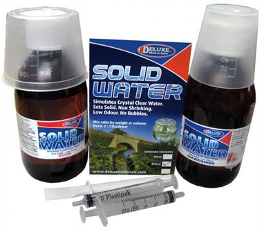 Deluxe Materials Solid Water 350ml DM103Simulates Chrystal Clear Water - special clear low odour resin. Easy to use, sets solid to simulate water in scenic or miniaturist modelling eg; aquaria, drinks, ponds.Kit contains resin, hardener, 2 syringes, mixing cup. Mixing ratio: 2 parts resin/1 part hardener. May be coloured with resinous toning dyes. Once set Solid Water is permanent.
