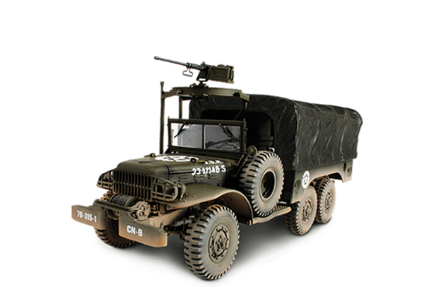 "Unimax Forces of Valor US 6x6 Truck<p>1/32 Scale</p>Dimensions - Length 7.0 in Width 2.4 in Height 3.5 in<p> Weight 0.6 lb</p><p>Designed as a Weapons/Troop Carrier the WC 63 was essentially a stretched version of the WC 51 with an additional axle making it a 6x6. This lengthening came as a direct result of the US Army's decision to increase the size of a rifle squad from eight to twelve men. With a 1.5 ton payload, the WC 63 could not haul as much as the ubiquitous 2.5 ton M35 ""Deuce-and-a-half"" but it was nevertheless produced in vast quantities and formed an integral component of the US Army's logistical force. Forces of Valor® 6x6 is constructed of die cast metal and plastic components. The open cab provides a clear view of the interior and includes a driver. A gunner figure grasps a movable M2 machine gun mounted to the machine gun mount over the right side of the cab. The rear cargo area features a removable cover with the look of canvas stretched over support beams and a movable tailgate. Additional details include a folding front windscreen and an assortment of battlefield equipment.</p>"