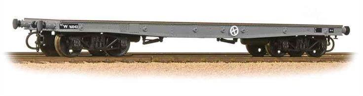 A new model of the War Department Warflat bogie flat wagon designed to convey heavy military vehicles during WW2.This model is painted in British Railways wagon grey.Era 5 1957-1966