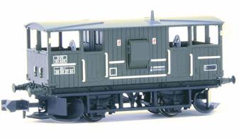 Nicely detailed model of the British Railways design Shark ballast train brake van finished in the olive green livery which replaced the original black on engineering wagons.The Shark brake vans were fitted with ballast ploughs designed to distribute clean ballast dropped from hopper wagons across and to the sides of the track as the train moved forward, greatly speeding up the spreading of fresh ballast.