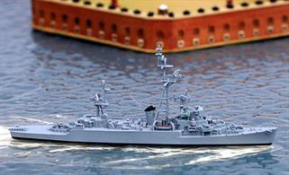A 1/1250 scale metal model of USS Harveson, a wartime destroyer escort converted later to a  more specialised role for the cold war.