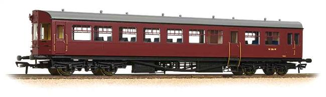 Dimensions - Length 275mm.A detailed model of the GWR style auto trailer coaches built by British Railways for use with class 14xx, 64xx and 4575 locomotives in push-pull trains.The models' detailed underframe includes suspended steps and representation of front end cab control apparatus along with a host of features such as bogies fitted with all axle phosphor bronze (low friction) bearings. The bodyshell features a detailed passenger interior and roof detail includes individually fitted GWR style shell vents. To cap off these great models, we have incorporated prototypical length buffers and buffer beam detailing accessories. Model painted in the BR lined maroon livery which was used from 1957. Era 5 1957-1966.