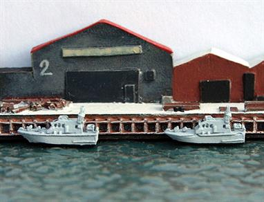 A 1/1250 scale metal, assembled, painted and finished model of HMS Archer & P163 HMS Express  a P2000 class patrol vessel.The class has a service speed of 20 knots and can carry an armament of just a general purpose machine gun.