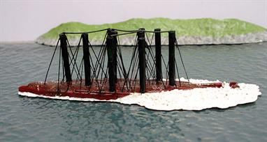 A 1/1250 scale resin model of the former German battleship, Friedrich der Grosse, modelled at the moment of salvage in Scapa Flow in 1937 by Metal Industries.Friedrich der Grosse had been scuttled at the end of the Great War in 1919 and was refloated using compressed air, a technique developed by Ernest Cox in the 1920s. The model shows the inverted ship at the moment of breaking the surface with the expanding air leaking from the hull.