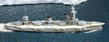 A 1/1250 scale secondhand metal model of the Russian battleship Marat in 1937 by Wiking. The model is in good condition for its age but it has been re-painted in light grey with weathered teak coloured decks. See photograph.