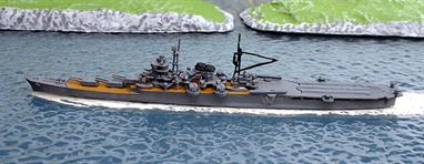 A 1/1250 scale secondhand model of the Japanese heavy cruiser Mogami in 1943 when the burnt out after turrets were replaced with a flight deck. This model is by Konishi of Osaka and is in very good original condition, number 311, see photograph.