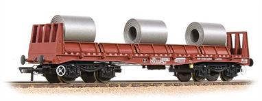 These wagons were updated versions of the traditional bogie bolster, being equipped specifically for the carriage of steel coil. Using standard fixtures the wagons could be loaded and unloaded quickly with modern mechanical handling machinery. The BAA wagons formed the backbone of the steel carrying fleet from the 1970s until new covered coil wagons were ordered by EWS in the late 1990s.