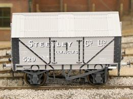 Detailed model of a 7 plank sided covered lime wagon with peaked corrugated iron roof based on RCH 1887 design specifications.Model painted in Steetley company livery with weathered finish.