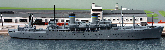 A 1/1250 scale model of USS General William O. Darby troop transport in 1950 by Solent Models SOM19.This ship entered service in the autumn of 1945 as Admiral W. S. Sims AP127 with a voyage to Bombay. There were 8 ships of this type entered military service but two more were completed as liners, President Cleveland & President Wilson. In 1946 she was transferred to the US Army and re-named and in 1950 she was transferred to the MSTS and gained the funnel band on this model. During the Berlin Airlift and after, she made 135 trips into Bremerhaven (the photograph shows her against the quayside at the Coastlines model of the Columbus Bahnhof).