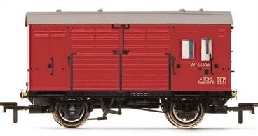 Detailed model of British Railways ex-GWR diagram N13 horse box W665 finished in BR crimson livery.These 1930s built horse boxes ran across the railway network to and from racing meets until the rail transport of livestock ceased in the 1960s.