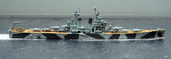 A 1/1250 scale second-hand model of USS Worcester with wood effect painted decks and wearing a camouflage pattern . The casting is by Hansa S90 and the neat painting is by a previous owner by we can find no record of such a pattern ever being applied either to this ship or its sister-ship, Roanoke, see photograph.