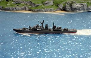 A 1/1250 scale second-hand model of JMSDF Yamagumo of 1966 by Delphin D99. This model has replacement gun turrets, detailed additions and a complete re-paint, see photograph.