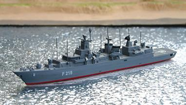 A 1/1250 scale second-hand model of a German Brandenburg-class frigate F215 by Albatros SM Alk52. This model is in excellent condition and has F215 on the hull but no i. d. letters on the helicopter deck and has red boot topping, see photograph