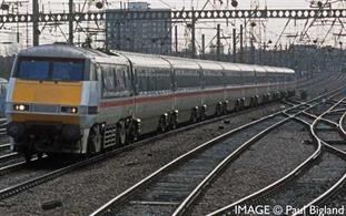 The electrification of the East Coast Mainline occurring in 1987 was almost complete, with deliveries of new electric Class 91s occurring when British Rail realised the Mk4 coaches and Mk4 DVT were still not ready to go into service. As a result, eight eastern region HST power cars were converted to operate as surrogate DVTs in tandem with the new electric locomotives and a rake of Mk3 coaches. The conversion process involved the fitting of buffers and remote-control equipment.
