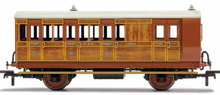 This four wheeled coach is a representation of the many which served on the Great Northern Railway (GNR) in the late 19th and early 20th century. Four wheeled coaches proved especially good at branch line work where their small size enabled the traversing of tight radius curves, whilst lower passenger numbers meant their small size was more acceptable and enabled trains to be hauled by smaller engines.This GNR coach is modelled as having step boards to enable access at stations with low platforms and gas lighting.