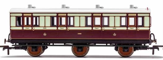 This six wheeled coach is a representation of the many which served on the London and North Western Railway (LNWR) in the late 19th and early 20th century. Four wheeled coaches proved especially good at branch line work where their small size enabled the traversing of tight radius curves, whilst lower passenger numbers meant their small size was more acceptable and enabled trains to be hauled by smaller engines.This LNWR coach is modelled as having step boards to enable access at stations with low platforms and oil lamp lighting.