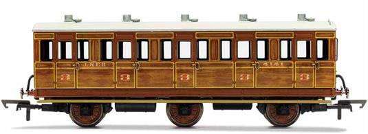 This six wheeled coach is a representation of the many which served on the London and North Eastern Railway (LNER) having been inherited form the Great Northern Railway (GNR). Small coaches such as this six wheeled coach proved especially good at branch line work where their small size enabled the traversing of tight radius curves, whilst lower passenger numbers meant their small size was more acceptable and enabled trains to be hauled by smaller engines.This LNER coach is modelled as having step boards to enable access at stations with low platforms and oil lamp lighting.
