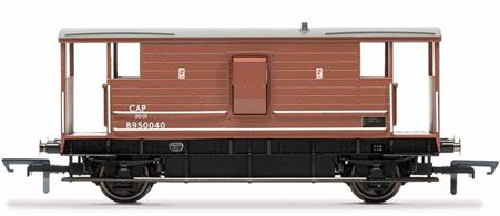 Until 1968, fully fitted freight trains were required by law to be carry a break van at the end. The brake van provided brake functionality to help slow the train as well as acting as a space in which the trains guard could carry out additional duties such as paperwork. As a result most brake vans featured a stove and desk on top of the brake apparatus. The London, Midland and Scottish Railway (LMS) built 2653 20 ton break vans between 1933 and 1947. These featured a wooden structure that spanned most of the frame, with open covered areas at either end to provide the guard with an excellent view of the train.