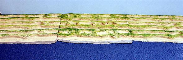 A 1/1250 scale model of a double row of coastal sand dunes by Coastlines Models CL-LA05(c+2xb) in polyurethane resin. The set comprises three modules with a total length of 72cm (30 inches), see photograph.
