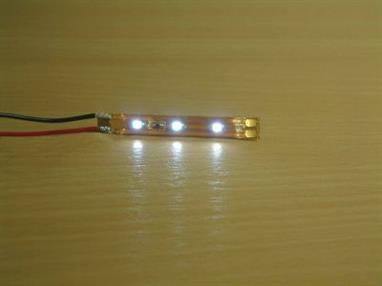 12-volt (DC) LED lighting strip with three surface-mount LEDs attached across a flexible copper track strip.Easy to fit inside model buidlings, model railway coaches and many other places where internal lighting is required.
