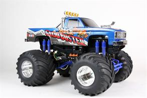 Tamiya 1/10 Super Clodbuster Twin Motor 4WD Monster Truck Kit 58518The Super Clod Buster is back! This monster truck features a body that was inspired by classic pick-up trucks from the 1980's, giving it a realistic appearance. The front grille, air intake and roll bar are recreated with metal-plated parts. The truck also features a twin-motor dual gearbox 4WD drivetrain, 8 coil spring dampers and massive 165mm diameter tires, as well as a 4-wheel drive steering system to help the model navigate tight corners.