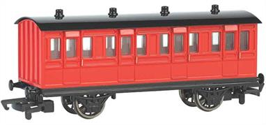 Model of a red liveried coach from the Thomas the Tank Engine books and TV series.