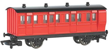 Model of a red liveried brake coach from the Thomas the Tank Engine books and TV series.