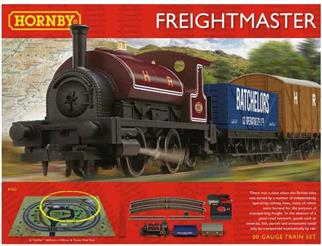 The Hornby Model Railways Freightmaster train set features a smart 0-4-0 saddle tank engine in deep red livery with a train of two goods wagons. The set is supplied with an oval of track, train speed controller with UK mains power supply adapter and track mat.