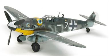 "This is a Tamiya plastic model kit of the german WW2 Messerschmitt Bf109, which was the most prolifically manufactured fighter in history; of its variants, the G-6 was the most numerous at 13,000 aircraft. In response to improving Allied foes in the air, Bf109 G aircraft had the more powerful DB605 engine, and from the G-6 were equipped with dual 13mm MG131 machine guns that required the distinctive bulges on either side of the cockpit cowling known as ""Beule."""