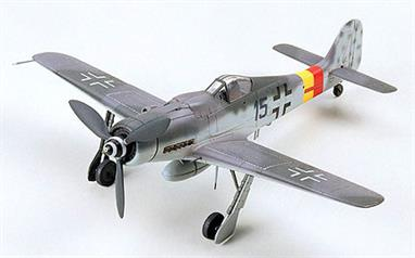 Plastic parts molded in gray and attached to sprues; clear pieces for canopy. Detailed landing gear and wheel wells. Detailed cockpit and instrument panel. Drop tank underneath plane.3-bladed propeller on nose. Engraved panel lines on body and wings of plane. Authentic decals for two aircraft versions. Detailed pictorial instructions.Glue and paints are required
