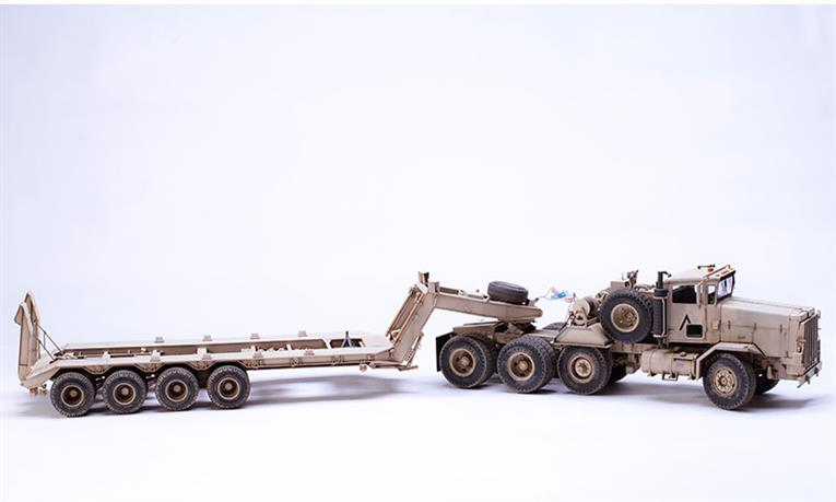 The SS-013 M911 C-HET (8X6) & M747 Heavy Equipment Semi-Trailer model kit contains 843 parts. It features complete cab and power system interiors. Some wheels are connected by metal axles. The trailer loading ramps are movable. The tractor's front wheels can be made in a steering position. Precision PE parts, reflective foil and mask stickers for cab windows are included in the kit.Length: 571.2mm   Width: 99.9mm