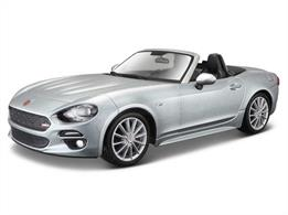 Diecast model of a 1:24 scale Fiat 124 Spider that has been recreated in meticulous detail. The exterior displays all of the slick curves and sweeping lines of the original, whereas the interior shows the same high attention to detail, featuring carefully crafted replica upholstery. The chassis is finished with an electrostatic paint coating, giving it the ideal final touch.